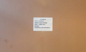 Photo of pamphlet on boarded up artwork