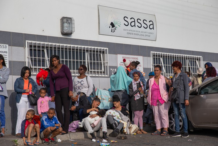 Photo of people waiting for social grants