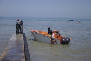 Photo of fishing boat and people
