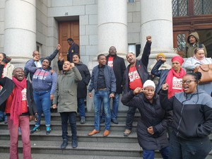 Photo of people outside court