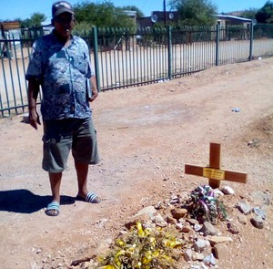 Photo of a man at a grave