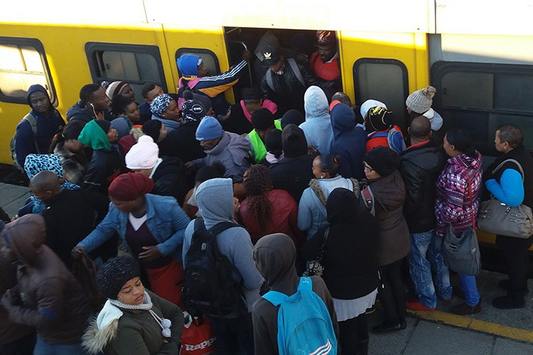 Photo of people on back of train