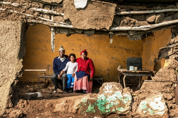 Photo of family in broken down house